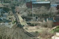 Cartsburn Viaduct and Junction viewed from above in 1988. The view looks west. The line to the right was the relaid Inchgreen branch with a connection laid in to the Wemyss Bay line at Containerbase Junction. The line ahead and to the left was the route from Kilmacolm to Princes Pier closed in 1966. The track was relaid in 1971to serve the Greenock container depot but was in abeyance by 1988.<br><br>[Ewan Crawford&nbsp;//1988]
