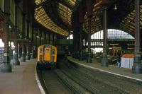 The 1840 station at Brighton, as it appeared on 8th October 1977, with some modernization work in progress. A four car Class 421 unit (No 7306) is about to depart.<br><br>[Mark Dufton&nbsp;08/10/1977]