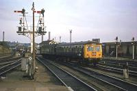 A pre-electrification scene at Norwich on 27th September 1977. A Cravens DMU is departing for Lowestoft.<br><br>[Mark Dufton&nbsp;27/09/1977]