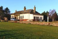Since my last visit a few years ago, the former Spey Bay Station has been refurbished and looks like new in December 2013. The grounds have been landscaped and the trees that hid much of it from view are gone. [See image 5588]<br><br>[John Gray&nbsp;04/12/2013]