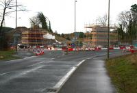 Approaching Hardengreen roundabout from Eskbank on 15 December, with work on the supports for the new bridge that will carry the Borders Railway well advanced.<br><br>[John Furnevel&nbsp;/12/2013]
