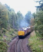 A pair of EWS class 37s with a southbound ballast train start to accelerate away from a stop at Aviemore in September 2004. The leading locomotive is 37406.<br><br>[John Furnevel&nbsp;14/09/2004]