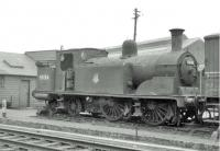 McIntosh ex-Caledonian 0-4-4T no 55124 in a siding alongside Dalry Road shed in May 1963. Built at St Rollox in 1895, the locomotive had been withdrawn in September 1961 and was stored awaiting disposal. That finally took place in the yard of Messrs Arnott Young, Troon, some four months after this photograph was taken.<br><br>[John Robin&nbsp;31/05/1963]