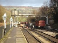 The north end of Grosmont NYMR Station on 15 December, showing the refurbished former Scarborough Falsgrave signal gantry framing the storage sidings. Maintenance work is in progress at the four way points on the connection to Network Rail beyond the platform end. <br><br>[David Pesterfield&nbsp;15/12/2013]