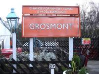 The station name board on the NYMR Grosmont Station main platform showing the route options available (winter Sunday excepted) from the Northern Rail Esk Valley line platform sited on the opposite side of the station car park. The initials of the photographer are also indicated below the board!<br><br>[David Pesterfield&nbsp;15/12/2013]