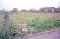 Looking west over the station site at Avonbridge in 1997. The gatepost was the only surviving reminder of the railway at the time, but even that has now gone.<br><br>[Ewan Crawford&nbsp;03/05/1997]