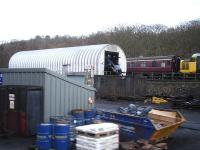 The open smokebox of 60007 <I>Sir Nigel Gresley</I> can be seen protruding from the purpose built maintenance facility on the east side of Grosmont NYMR Shed complex on 15 December. The nose of large logo liveried class 37 no 37264 is also in the picture.<br><br>[David Pesterfield&nbsp;15/12/2013]