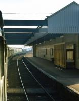 An up ECML service at Dunbar at 12:15 on September 12th 1971. The locomotive is class 46 <I>Peak</I> No. 148 and the train is the 11:40 Waverley to Kings Cross relief. It was rather a slow journey to Berwick, with slowings for engineering works necessary at various points, including wrong line working between Craigentinny and Joppa. <br><br>[Bill Jamieson&nbsp;12/09/1971]