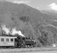 Zillertalbahn No. 5�<I>Gerlos</I>�is nicely lit by the sun on a clear Alpine afternoon as it approaches Angererbach halt shortly after leaving Kaltenbach with the 15:02 steam service to Mayrhofen. The River Ziller, after which the valley (and the railway) takes its name, is just on the other side of the trees immediately behind the train.<br><br>[Bill Jamieson&nbsp;02/10/2013]