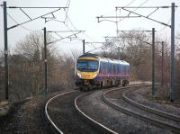 First Transpennine 185127 with the 07.25 service from Manchester Airport to Edinburgh, a little to the east of Curriehill on 17 December.  Soon to be replaced by a class 350 electric unit...<br><br>[Bill Roberton&nbsp;17/12/2013]