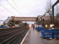 Looking north along the up platform at Westgate, with the 08.23 CrossCountry Voyager for Plymouth approaching. The new station building opens for business this Sunday 22 December.<br><br>[David Pesterfield&nbsp;18/12/2013]