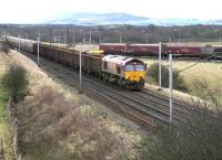 A northbound freight passing Ravenstruther in December 2005 behind EWS 66081. The locomotive has just passed the tail end of a train about to run through the coal loading terminal with 66212 at the other end [see image 5590].<br><br>[John Furnevel&nbsp;19/12/2005]