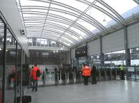 Looking towards the automatic ticket gates over the new concourse at Haymarket on 19 December 2013.<br><br>[John Yellowlees&nbsp;19/12/2013]