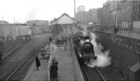 With interested observers hanging onto the iron railings on Lindsay Road, 57550 prepares to depart from Leith North on 3 February 1962 with the SLS <I>Peebles Railtour</I>. (The tour had started from Princes Street and would terminate at Waverley.) Note the traffic on Lindsay Road this particular Saturday afternoon - consisting of a bus! [See image 1082]<br><br>[David Stewart&nbsp;03/02/1962]