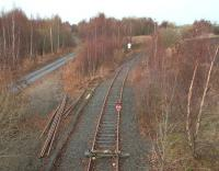 A STOP banner augments the pair of wooden sleepers chained across the rails near the site of Millerhill South Junction in December 2013. The line ahead gave access to Millerhill Yard east as well as providing a link to the ECML via Millerhill East and Monktonhall Junctions. [See image 35723] <br><br>[John Furnevel&nbsp;20/12/2013]