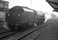 Upperby shed's 46250 <I>City of Lichfield</I> waits expectantly on the centre road at Carlisle on Leap Day 1964. The Pacific is awaiting the arrival of the 9am ex-Perth, which it will take south. [See image 34634]<br><br>[K A Gray&nbsp;29/02/1964]