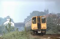 <I>Ormskirk to Glasgow?</I> EMU 507022 approaches Ormskirk from Liverpool in 1980. This set was subsequently disbanded (around 1995 following an accident at Kirkdale) and one of the driving cars now operates out of Glasgow Central in EMU 314203 replacing the coach damaged in the Newton collision [see image 22690]. Replacement of the Merseyrail Class 507s and 508s is now being put out to the train builders but in 2013, livery apart, this scene is unchanged from thirty three years earlier. <br><br>[Mark Bartlett&nbsp;//1980]