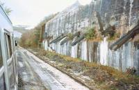 Old clay chutes near Bugle, photographed from a window of <I>The Royal Duchy</I> DMU Railtour in April 1997, during a visit to some of the remote clay branches in Cornwall. [See image 36516]<br><br>[Ian Dinmore&nbsp;30/04/1997]