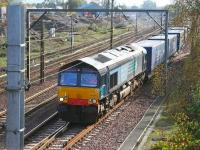 DRS 66406 lifts the Tesco containers out of the down loop at Beattock on 12 October 2006, after being sidelined to make way for a northbound Voyager. [See image 11726]<br><br>[John Furnevel&nbsp;12/10/2006]