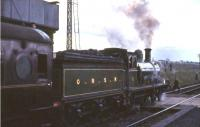 Ex-Great North of Scotland Railway 4-4-0 No 49 <I>Gordon Highlander</I> in the process of taking on water at Auchengray on 19 April 1965 with <I>Scottish Rambler No 4</I>. The special was on its way from Leith Central to Carstairs. <br><br>[G W Robin&nbsp;19/04/1965]