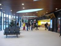 Looking along the concourse of the newly opened Wakefield Westgate station up side main building, with retail units and the brightly lit platform entrance on the right. The ticket office is at the far end of the concourse.<br><br>[David Pesterfield&nbsp;24/12/2013]