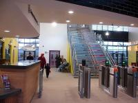 Looking from the concourse to the platform 1 access doors and footbridge steps at the newly opened Wakefield Westgate station up side main building on Christmas Eve 2013.<br><br>[David Pesterfield&nbsp;24/12/2013]