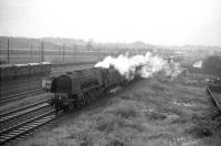 Stanier Pacific no 46228 <I>Duchess of Rutland</I> passes Carlisle Upperby with a down parcels train on a wet Wednesday in June 1964.<br><br>[John Robin&nbsp;17/06/1964]