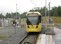 A Metrolink tram leaves the temporary Oldham Mumps stop heading for Rochdale in July 2013. For an approximate Then and Now comparison at this location five years earlier [see image 21173]. This temporary stop closed on 18th January 2014 and the lines and catenary were removed completely by August that year. The area will be redeveloped now the new town centre street running section is open. <br><br>[Mark Bartlett&nbsp;31/07/2013]