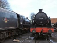 Stanier Black 5 45379 stands alongside Maunsell 'U' Class 2-6-0 31806 in Ropley shed yard on 28 December 2013.<br><br>[Peter Todd&nbsp;28/12/2013]