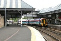 An Edinburgh - Dundee train arrives at Perth platform 2 on 15 June 2006, while in the background an Inverness - Glasgow Queen Street service is leaving platform 4.  <br><br>[John Furnevel&nbsp;15/06/2006]