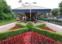 A Northern service to Blackpool North photographed in June 2012 calling at Poulton-le-Fylde station. The platform decoration includes bunting and a�very tidy flower bed.<br><br>[John McIntyre&nbsp;16/06/2012]
