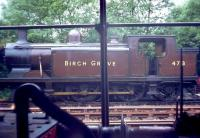 Class E4 0-6-2T no 473 <I>Birch Grove</I> seen through a window on the Bluebell Railway in 1971.<br><br>[John Thorn&nbsp;/07/1971]