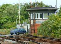 The impressive signalbox next to Albert Road level crossing at the north end of Deal station in Kent. Photographed from the platform on 2 July 2012 looking towards Sandwich. The signalbox is a notable example of Southern Railway 1930s Odeon/Art Deco <I>glasshouse</I> design.<br><br>[John McIntyre&nbsp;02/07/2012]