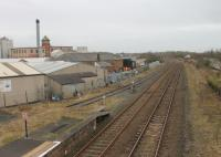From the Wigton station footbridge the <I>Innovia</I> cellophane factory complex can be seen. This featured in a <I>Michael Portillo</I> railway journey along the Cumbrian Coast although the internal sidings no longer receive rail traffic. View towards Maryport in February 2013<br><br>[Mark Bartlett&nbsp;03/02/2013]