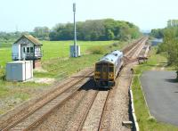A York to Blackpool service, formed by 158909, approaches Salwick station on 22 May 2012. On the left is Salwick No 2 SB which is scheduled for closure with the electrification of the line from Preston to Blackpool North. On the right the loop remains, along with the ground frame and point leading to the�former sidings in the Westinghouse, Springfields industrial complex.<br><br>[John McIntyre&nbsp;22/05/2012]