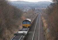 Looking north to Kingskettle from Forthar on 5 January, with 66103, 66069 and 66206 each on a train of reclaimed track and ballast from Ladybank.<br><br>[Bill Roberton&nbsp;05/01/2013]