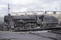 Black 5 no 45157 <i>Glasgow Highlander</i> on the turntable at Eastfield shed in the summer of 1961. Only 4 of the 842 Black 5s carried names during their normal operational service, although several have since been named in preservation.<br><br>[John Robin&nbsp;/07/1961]