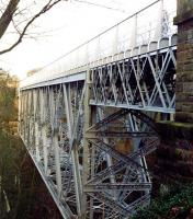 A notable early example of steel box lattice girder construction, is the 1892 Bilston Glen viaduct on the former Glencorse branch. The viaduct, with its impressive 135m span, is seen here looking north towards Loanhead in 2003. The structure was restored during the 1990s. <br><br>[John Furnevel&nbsp;25/10/2003]