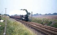 The up <I>Granite City</I> photographed near Cumbernauld in the late summer of 1965. On this occasion Perth Black 5 no 45473 is standing in for a failed diesel locomotive.<br><br>[G W Robin&nbsp;31/08/1965]