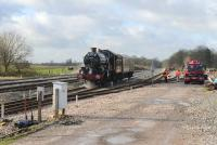 5029 <i>Nunney Castle</i> has stopped to take on water in the up loop at Woodborough, between Newbury and Westbury, on 9 November 2014. The <I>Castle</I> was on its way from Minehead to Southall. <br><br>[Peter Todd&nbsp;09/11/2014]