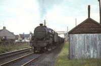 <I>Crab</I> 2-6-0 no 42789 heading south past its home shed at Ayr in August 1965 with mineral wagons.<br><br>[G W Robin&nbsp;08/08/1965]