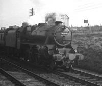 Black 5 no 45278 brings a down train past the ex-LMS shed (6A) on the southern approach to Chester station in April 1962. [Ref query 5818]<br><br>[K A Gray 14/04/1962]