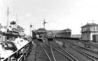 A DMU from Glasgow stands at Stranraer Harbour station on 5 August 1962. Berthed on the left is <I>Caledonian Princess</I>, recently arrived from Larne. <br><br>[David Stewart&nbsp;05/08/1962]