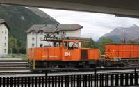 Grab shot of the resident metre gauge <I>steeple cab</I> shunter at Samedan where the lines from Chur, Scuol, St. Moritz and Tirano meet. RhB 214 is one of two built for the railway in 1984 with three powered axles working from the 11kv overhead system. <br><br>[Mark Bartlett&nbsp;16/09/2013]