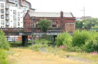 Looking east across the overgrown platforms at Partick Central in August 2006, with the old booking office standing above on Benalder Street. The station opened in 1896 and closed to passengers in 1964, after undergoing a name change to Kelvin Hall for its final 5 years. The building was demolished 5 months later [see image 13369].<br><br>[John Furnevel&nbsp;27/08/2006]