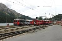 Although St. Moritz is a terminus (of three main lines) all platforms are through roads with stabling sidings beyond. A lineup of Rhaetian metre gauge rolling stock and motive power is stabled alongside the lake in September 2013. <br><br>[Mark Bartlett&nbsp;16/09/2013]