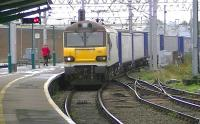 DBS 92002 moves 4S43 Daventry to Mossend Tesco Containers through platform 1 at Carlisle on 17 October.<br><br>[Ken Browne&nbsp;17/10/2013]