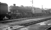 Stanier 2-6-0 no 42966 stabled on Bushbury shed in the summer of 1962.<br><br>[K A Gray&nbsp;15/08/1962]