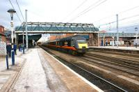 A Grand Central HST set disappears northwards on the through road at Doncaster on 12 March 2013.<br><br>[John McIntyre&nbsp;12/03/2013]