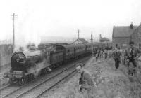 NBR 256 <i>Glen Douglas</i> makes a photostop at the closed Madderty station on 23 April 1962. The locomotive was on its way from Methven Junction to Crieff with the BLS / SLS <i>Scottish Rambler</i>. [Ref Query 12798] [See image 11597]<br><br>[David Stewart&nbsp;23/04/1962]